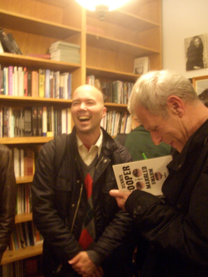 me laughing with Dennis Cooper about our favorite international male slaves