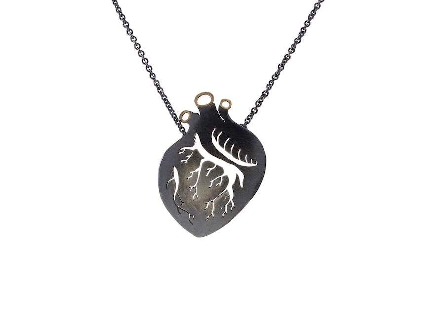 Luana Coonen's silver and gold love necklace, photo credit to Luana Coonen.